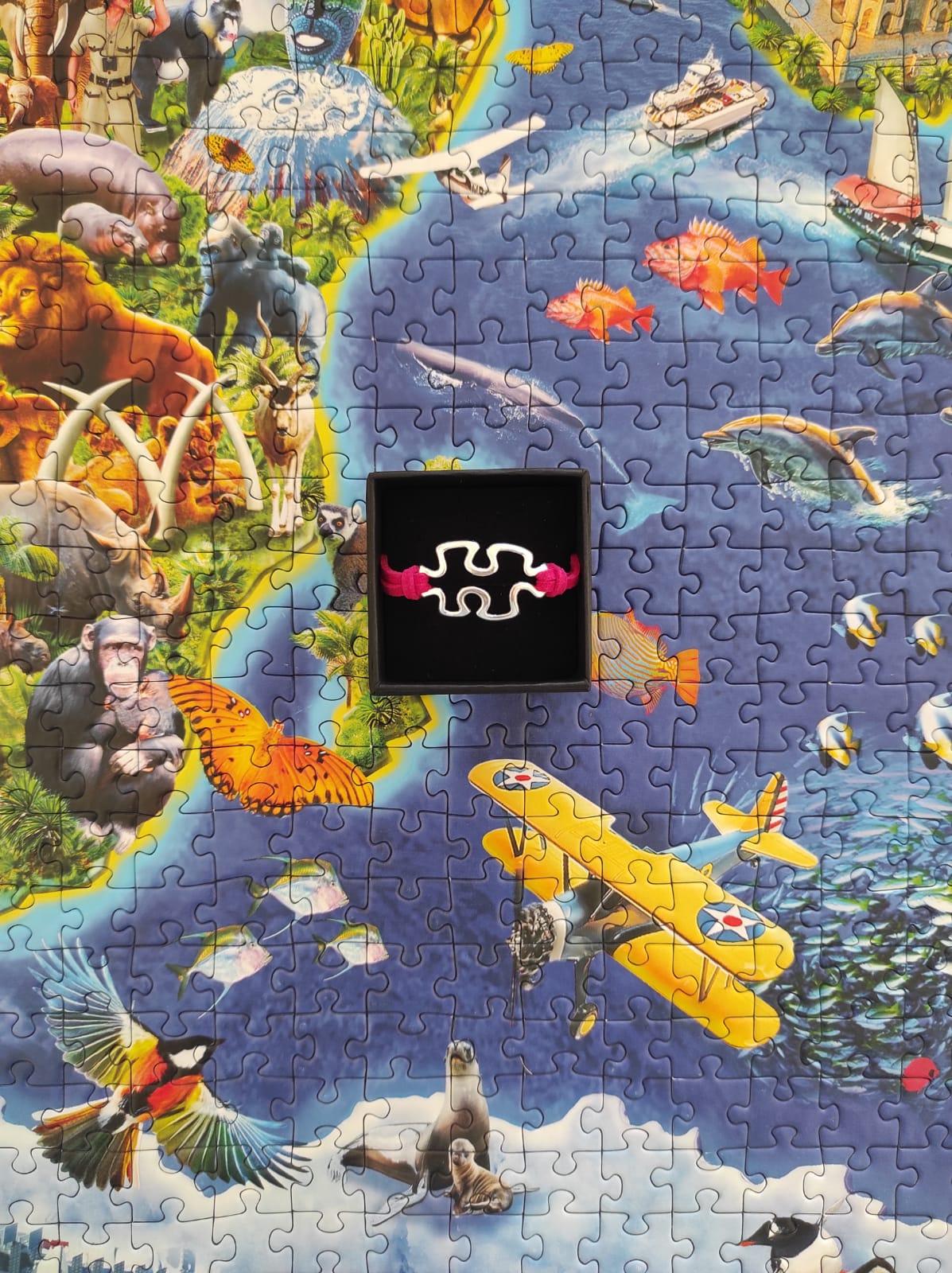 Pulsera unisex puzzle con cierre roja